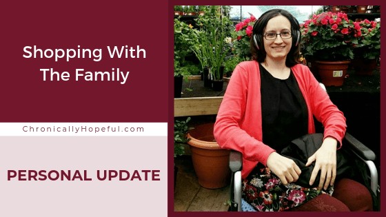 Char sitting in a wheelchair in a botanical nursery. Title reads: shopping with the family, Personal Update.