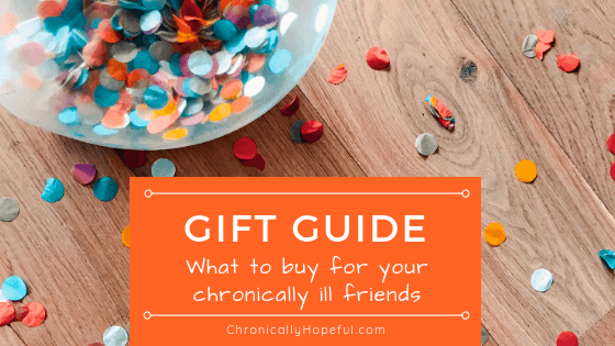 A bowl of colourful confetti spilled on a wooden table. Title says, Gift guide, what to buy for your chronically ill friends.