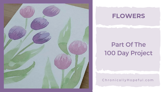 Watercolour tulips on a card. Title reads Flowers, Part of the 100 day project.